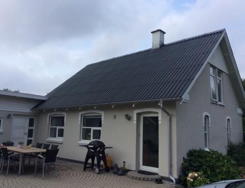 Villaen i Tørring fik renoveret det eksisterende tag.